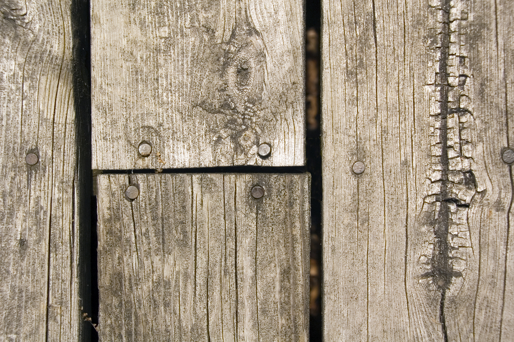 Weathered wooden planks of platform in park, close-up from above